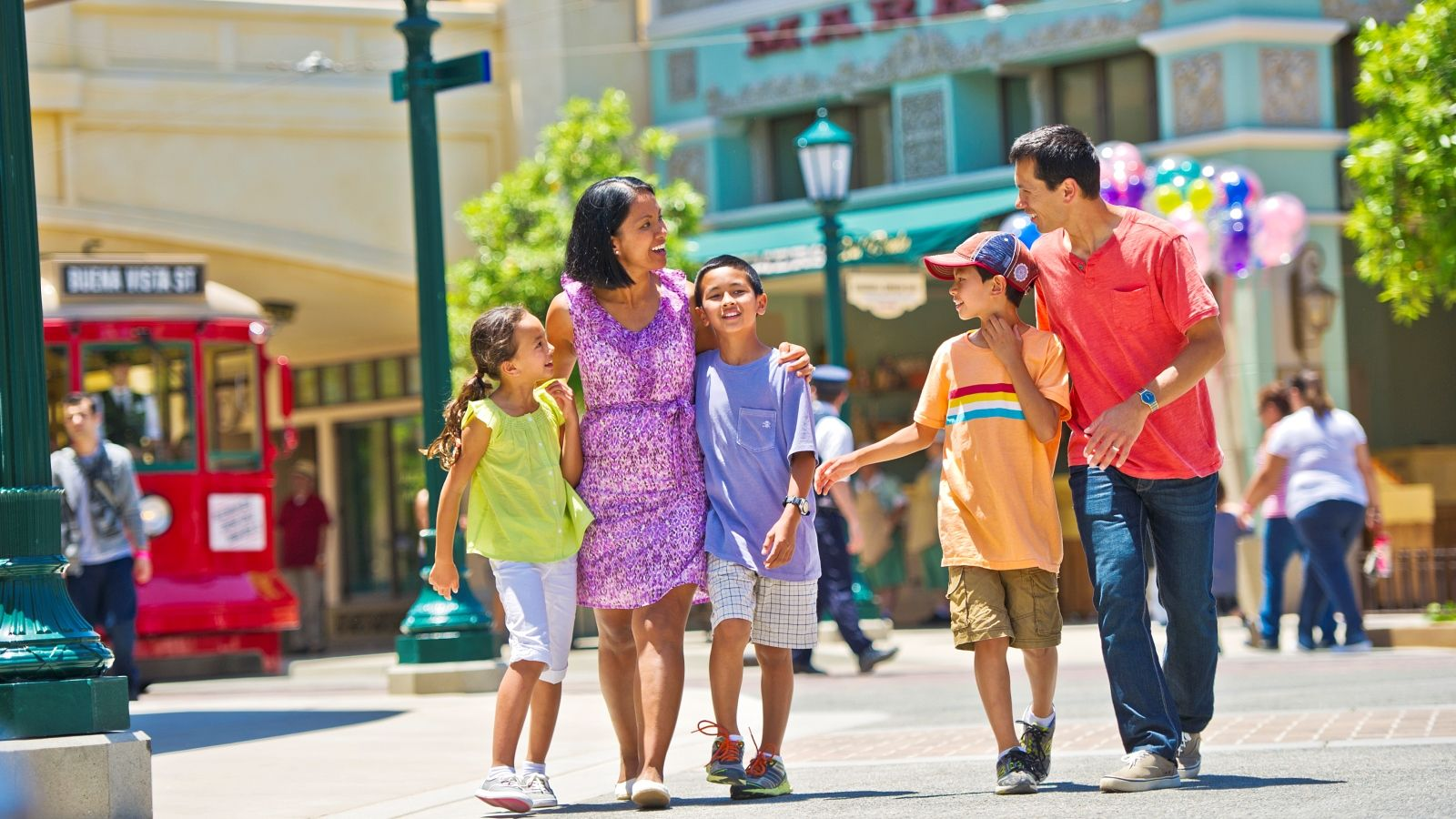 family-strolling-downtown-disney-district